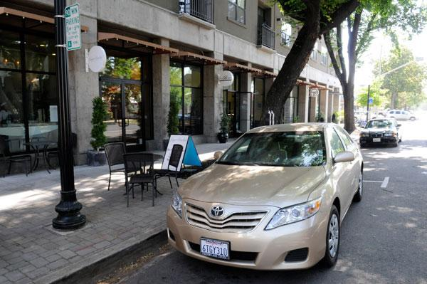 The city is planning to update its parking standards to reduce the number of spaces required for  urban businesses, like Ginger Elizabeth Chocolates on L Street.