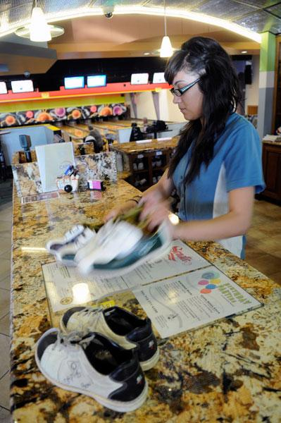 Manager Judyth Gutierrez works the counter at Capitol Bowl, which offers Foursquare deals.