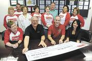 Campbell Soup employees on Friday presented the United Way with a check for $78,895.