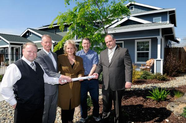 Dan Wilson of Habitat for Humanity is shown at left with Norm Scheel, Roberta Walker, Marcus Romani and Rob Coon at the site of two LEED-certified houses on 21st Avenue in Sacramento.