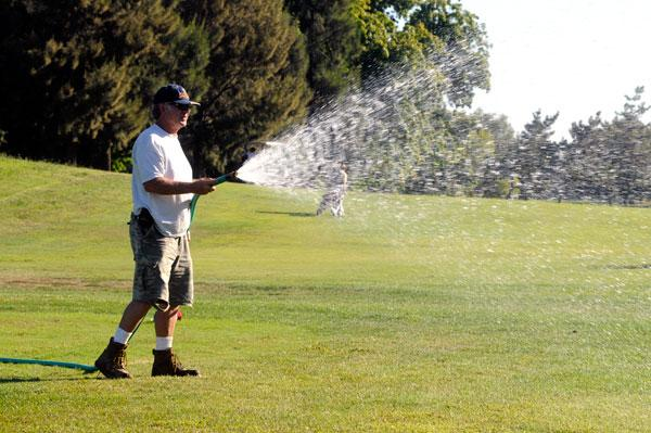 Bob Carrigan waters some dry spots Wednesday at the Haggin Oaks Golf Complex. As of Jan. 1, the city hopes to save money by turning over its maintenance to a private contractor.