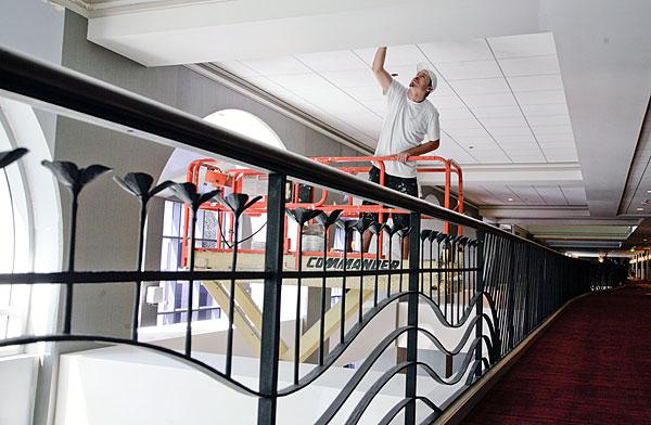 In this September file photo, a worker puts finishing touches on a ceiling at the Hyatt Regency Sacramento. Now, the second phase of its interior renovation of the public spaces in the hotel is complete.