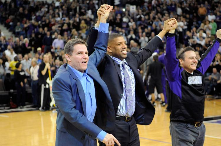 "Joe Maloof, left, Kevin Johnson and Gavin Maloof take the floor during a Feb. 28 Kings game to celebrate the arena deal. But the team, owned by Maloof Sports & Entertainment, is now saying that as a tenant of the proposed downtown arena, it should not have to pay a portion of $13 million in ""predevelopment costs"" such as site work and engineering needed to start the process of building the arena."