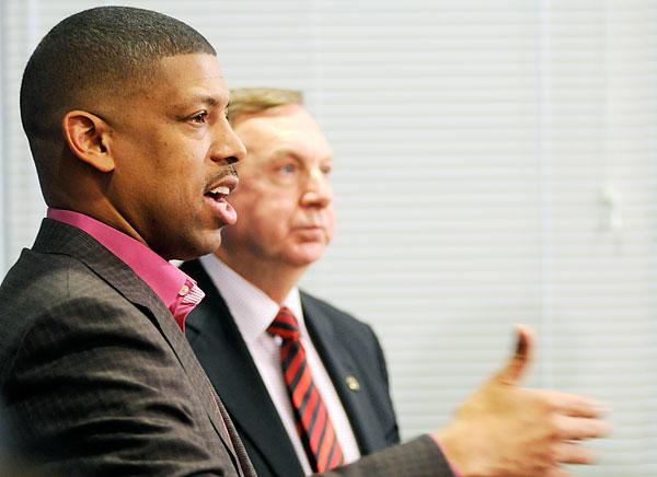 Sacramento Mayor Kevin Johnson, foreground, has vowed to assemble a group of investors who would buy the Sacramento Kings and keep them in town. Some experts give the rescue effort little hope for success.