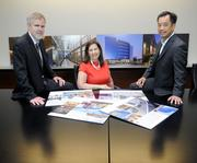 LPAS Architecture + Design: Architect of the Year.  Ron Metzker, left, Theresa Paige and Curtis Owyang display pictures of some of the projects that earned LPAS the title of Architect of the Year. The company designed two of this year's winning projects and two others that were finalists.