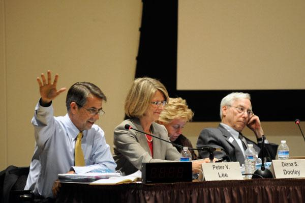 State Health Benefits Exchange executive director Peter Lee, left, and exchange board members meet Tuesday.