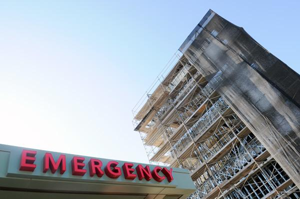 Mercy General Hospital's new Alex G. Spanos Heart & Vascular Center casts a shadow over the emergency room.