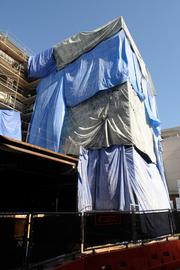Tarps cover a portion of the Mercy construction to limit dust and to provide some shade for the workers.