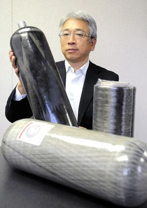 "Grafil president Masayoshi ""Matt"" Ozeki holds one of the company's carbon fiber vessels that contains pressurized gasses or liquids."