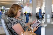 Tammy Pineda works on her iPad while waiting for a flight at Sacramento International Airport.