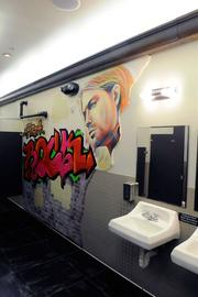 The bathroom at Pizza Rock is painted with a street mural.