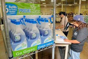 Harvinder Rai, left, and Nancy Hernandez apply labels and package PrideClean products in Roseville.