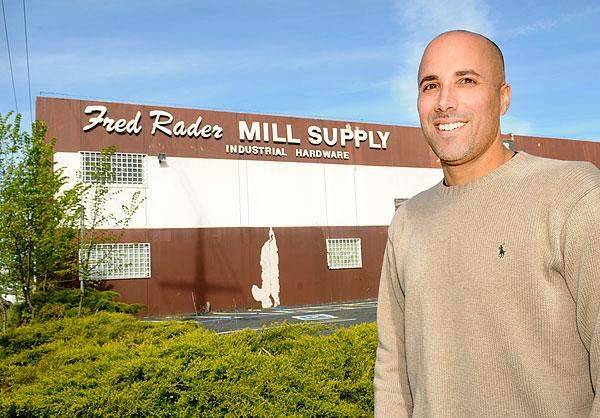 Jim Quessenberry is one member of a group of investors who plan to convert the former Fred Rader Mill Supply building into a space that will attract offices and retail with lower rents than comparable midtown buildings. A nearby resident appealed approval of the redevelopment, saying it would create parking and noise problems, and that it's an inappropriate location for public alcohol use.