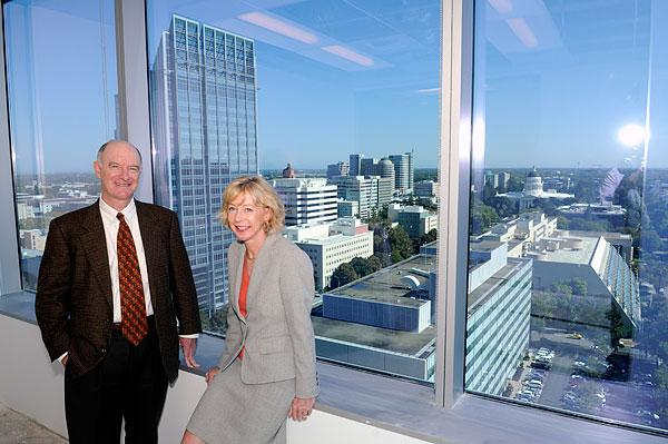 BB&K partners Edward Quinn Jr. and Ann Siprelle show off the spectacular view of their law firm's future location on the 17th floor of 500 Capitol Mall in the Bank of the West Tower.