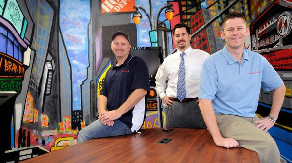 Shawn Cash, left, Bill Louie and J.C. Swan founded local startup Retail Radio.