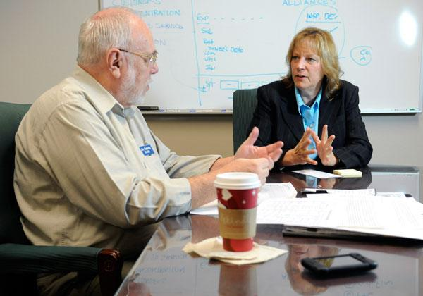 International Wafer Service owner Susan Hausler, right, turned to mentors, including SCORE's Jim Roberts, for advice after she took over her family's company.