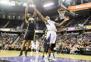 The Kings' Thomas Robinson, right, defends against Indiana's Sam Young during a game last November. The Kings provide the Sacramento region with jobs, entertainment and prestige.