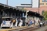 Amtrak passengers, like these at the Sacramento depot, could see speedier service on the San Joaquin line within six years if planned track upgrades are completed.