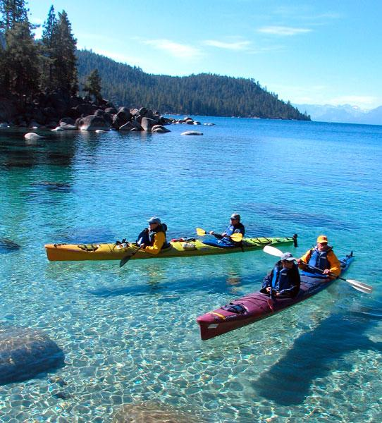 Kayakers ply the crystal-clear watersofSand Harbor at Lake Tahoe.