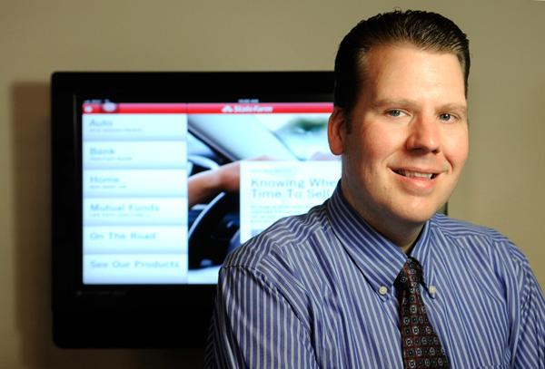 Scott Brown shows off the State Farm Pocket Agent, available for mobile devices.