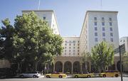 The Senator Hotel office building has been added to distressed-property lists.