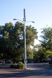 Davis puts cell phone antennas on top of light poles.