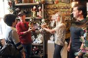 From left: Marcy and Rodney Seigfried choose decorations with the help of Christmas & Co. owners Amy Guthrie and Mark Snyder, who also own Chef's Mercantile.