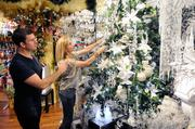 Christmas & Co. owners Mark Snyder, left, and Amy Guthrie decorate their store in preparation for the holidays.