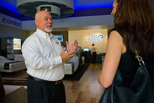 Salesman Joe Soldevila talks with a customer at the Westfield Galleria at Roseville's Got Sleep? store, Sleep Train's first mall-based mattress store, which also offers sleep-related accessories like noise machines.