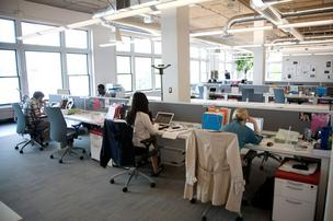 "The open office layout of StudentsFirst features ""benching"" — a concept where employees have a small, 5-foot by 30-inch place to work."