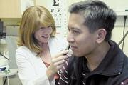 Nurse practitioner Tyla Healton examines Marvin Talusik at the Sutter Express Care clinic inside the Rite Aid store in Natomas.