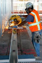 With all the steel beams ready, workers put the metal frames into place at Sutter.