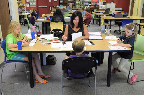 Instructor Natasha Novak helps, from left, Sarah Schlegel, Nicholas Perkins and Kethry Goldfein at the Sylvan Learning Center in Roseville.