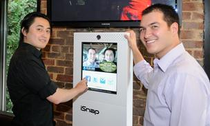 Dat Tau, left, and Alexander Lowe have sold 130 units of their iSnap photo station since they launched the company in 2010 and are planning to release new products in October.