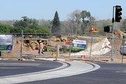 A new light-rail line extends across Richards Boulevard into the Township 9 development.