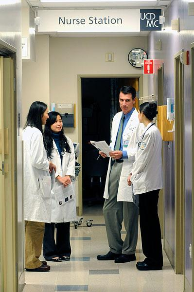 Dr. Thomas Balsbaugh, residency director for Family and Community Medicine for the UC Davis Health System, consults with residents, from left, Wendy Lam, Kimberly Tran and Leslie Phillips.