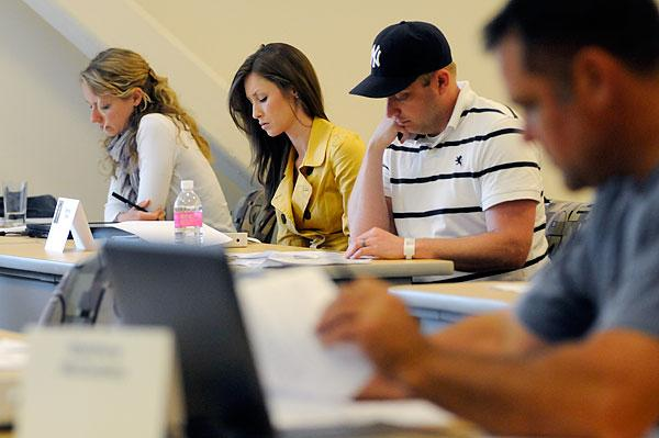 """Students in class for a summer course in the UC Davis """"Working Professionals"""" MBA program."""