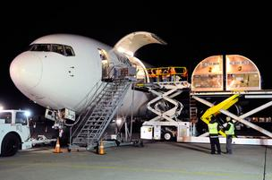 UPS workers at Mather Airport load a Boeing 767 with freight bound for Louisville, Ky.