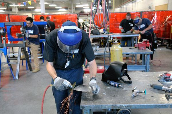 Matthew Anderson smoothes out some rough edges at the Universal Technical Institute's machine shop in Natomas.