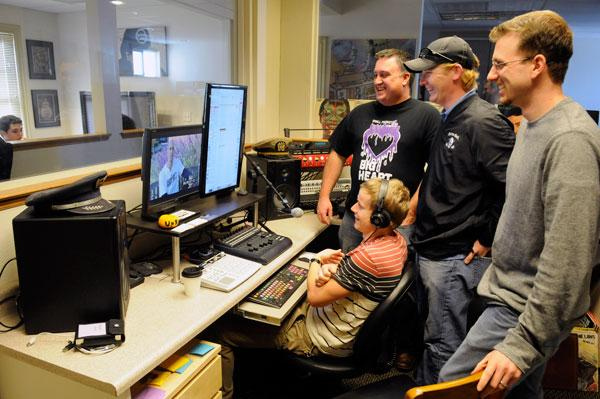 """Director Tobin Halsey, standing left, producers James Ham and Blake Ellington work with John Glover, seated, on the score for """"Small Market, Big Heart,"""" a documentary about the Kings."""
