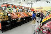 More shopping centers are looking to fill vacancies with mid-size grocers such as Walmart Neighborhood Market.