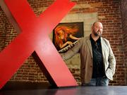 TedX, a Sacramento group that convenes conferences on big ideas about technology, entertainment and design, had been on hiatus since 2010, but group curator Brandon Weber saw there was still interest in the series, which was held Aug. 31.    Weber had this big red X in his office -- the perfect prop for big ideas. I carefully placed the X on the table so the face in the painting would be visible through the top of the X. Her red hair fit perfectly with the color of the X, as light entered through a large window. I just wish the table was red.    From the story: TEDx re-emerges in area with three events