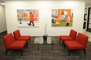 The goal of Weintraub Tobin's tenant improvement project was to create an open, fresh and modern-looking space. Key elements include big splashes of red, bleached hardwood floors, a large wood wall and a glass-walled conference room.
