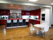 The well-equipped and boldly colored kitchen on Weintraub Tobin's 10th floor is an inviting place for employees to take breaks and eat lunch with co-workers.