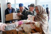Smiles are plentiful as food is handed out last week at the Food Bank of Yolo County.