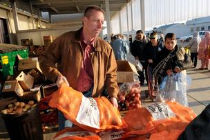Paul Curtis, director of development at the Food Bank of Yolo County in Woodland, hands out potatoes earlier this month.