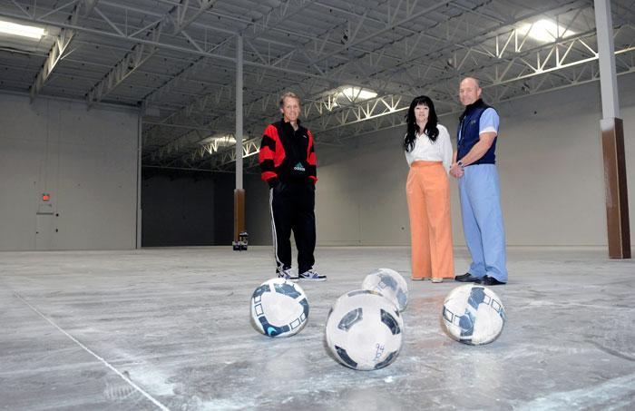 Gregg Thompson, left, Jonna Ward and Dr. Steve Schorer bought a Rocklin warehouse to turn into a soccer complex.