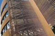 "The exterior of La Valentina Apartments incorporates a ""rain screen"" that keeps driving rain off the building."