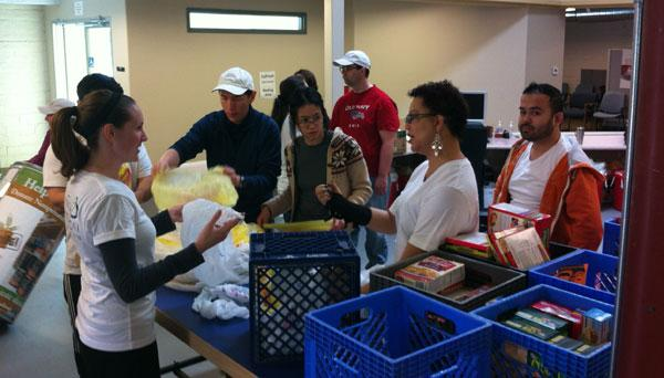 Employees at the architectural firm Lionakis help with food donations at the River City Food Bank.