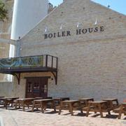 The exterior of the new Boiler House Texas Grill & Wine Garden at Pearl Brewery. The restaurant recently had a soft opening.